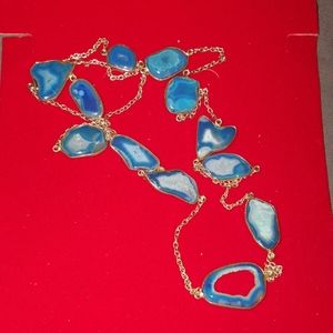 Blue stone and silver tone necklace